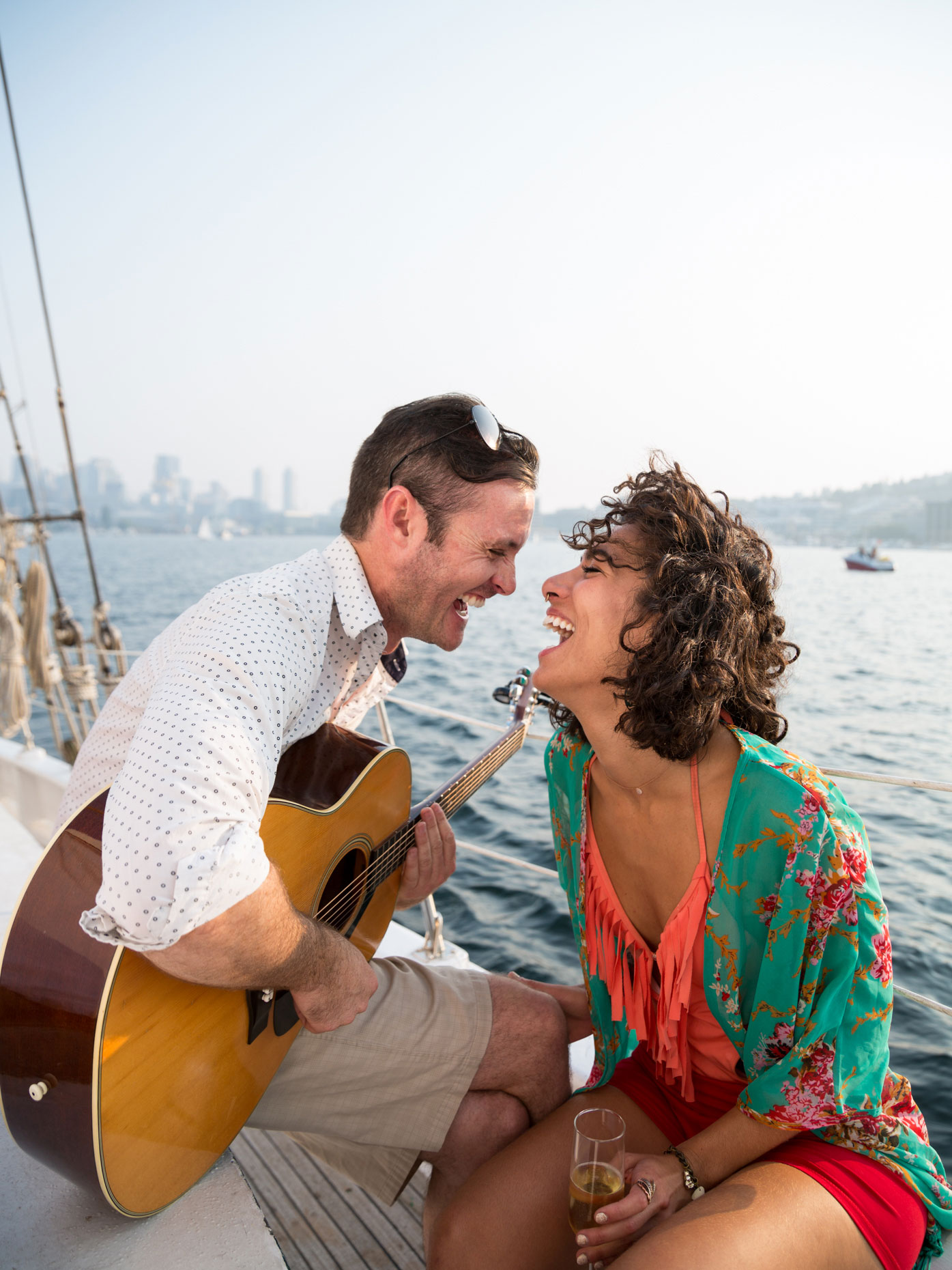 Laughing couple on sailboat