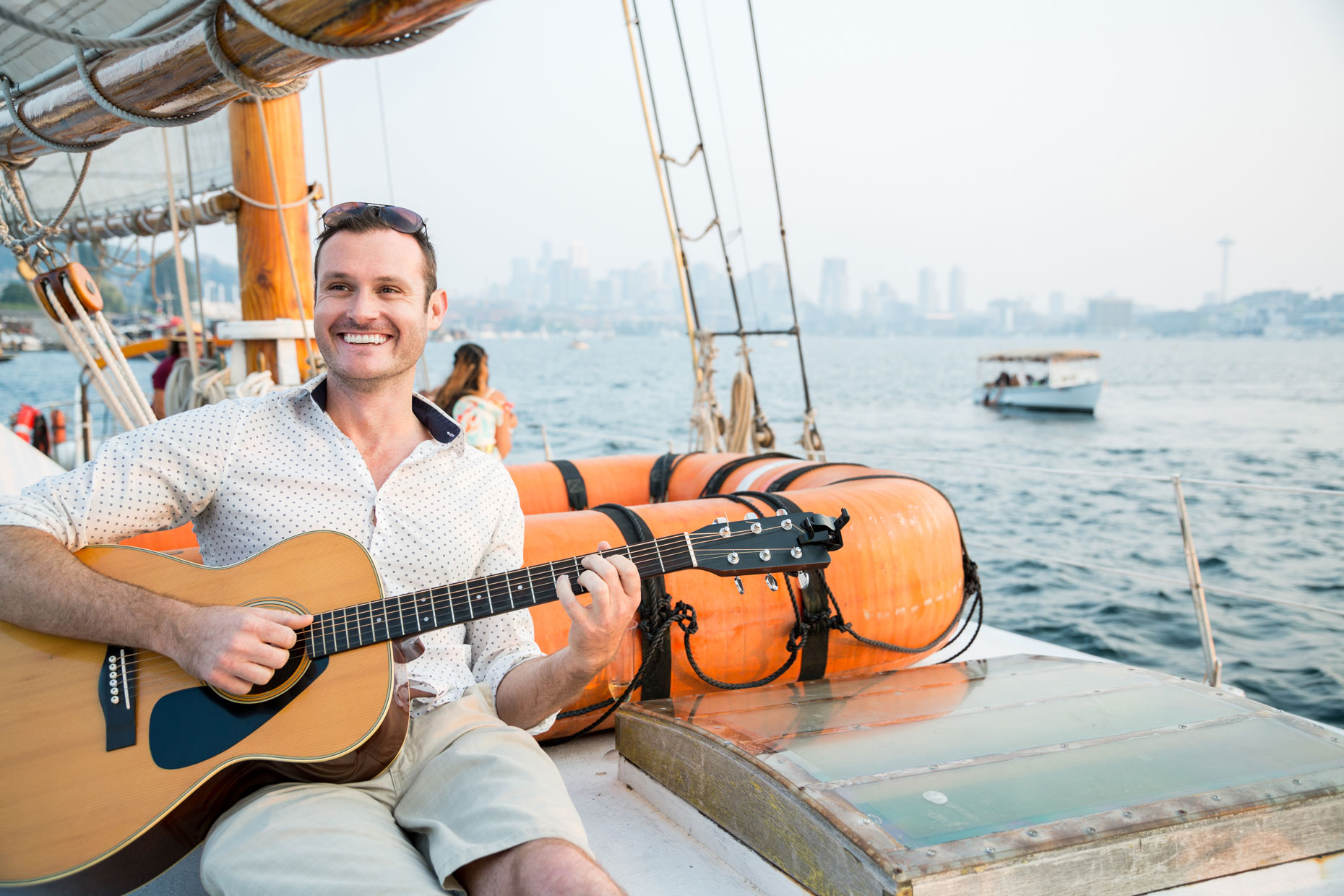Guitar player on sailboat