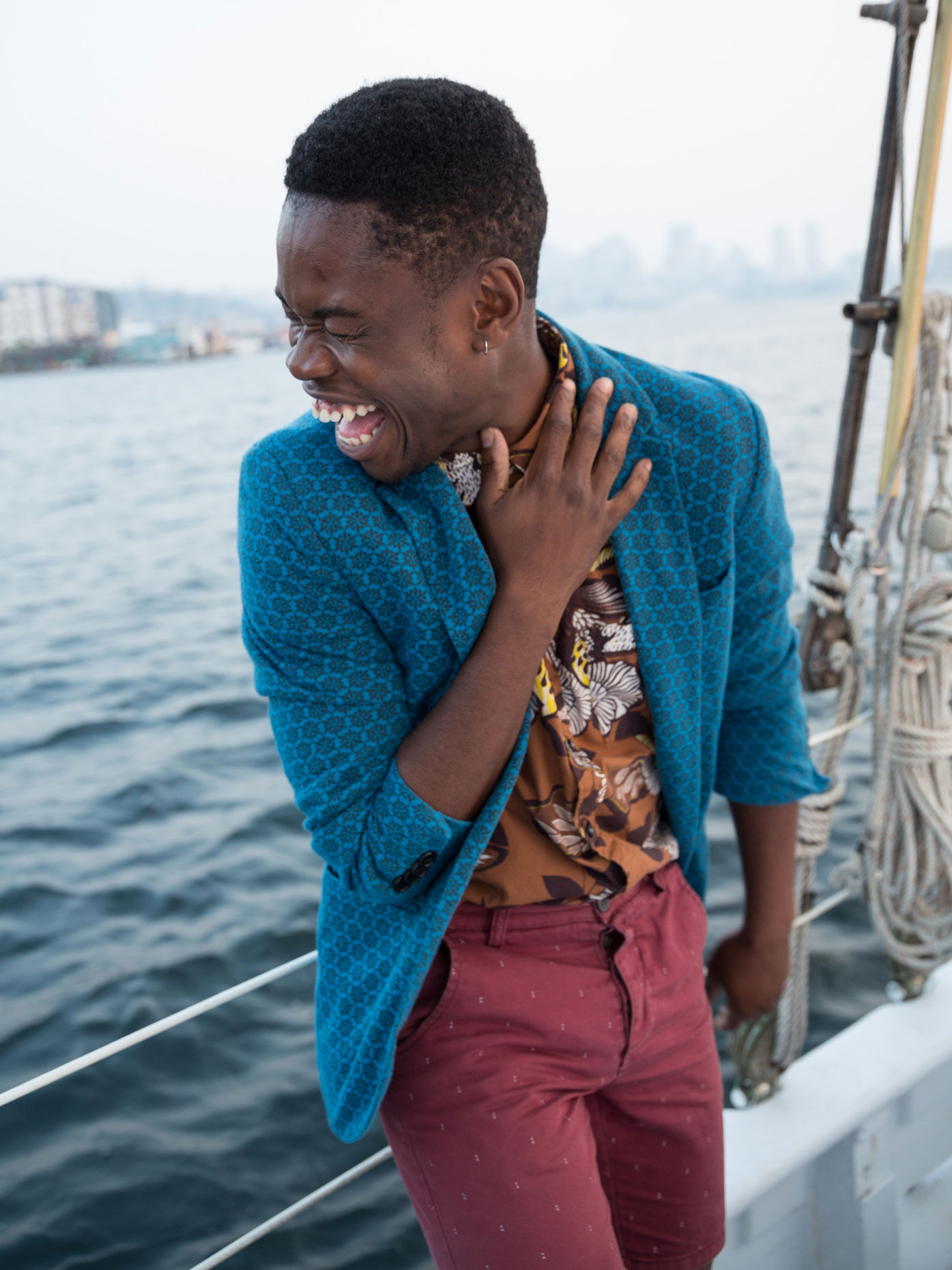 Laughing man on sailboat